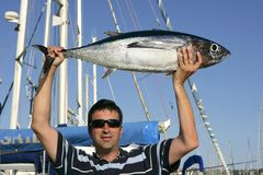 Big game fisherman with saltwater tuna Royalty Free Stock Photography