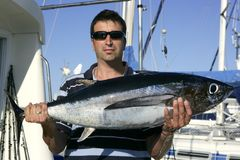 Big game fisherman with saltwater tuna Royalty Free Stock Image