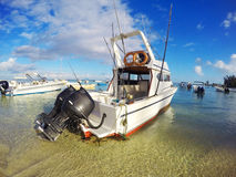 Big game fishing boat. Big game fishing boat with two engines in marine on Mauritius Island Stock Image