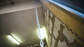 Big garage chain hanging stock video footage