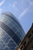 The Big Gherkin. This is a image of the modern building called the Gherkin. It can be used to represent modern architecture Stock Photo