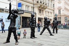 Big Ghosts. Four large bronze statues   Big  Ghosts by artist Thomas Schuette are displaced  from may to november 2011 in Graben in central Vienna. Foto was Royalty Free Stock Image