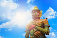 The Big Giant guardian statue on blue sky with cloud background. In Thai Temple,Thailand Stock Photo