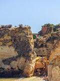 Big, giant stones, rocks, boulders, at Praia da Batata, Lagos, P royalty free stock image