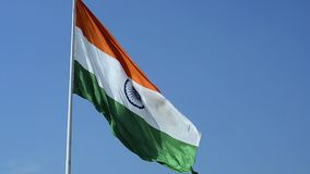 Big Waving Indian National Flag tricolour flying on blue sky outdoor daylight. Big giant Waving Indian National Flag tricolour flying on blue sky outdoor stock video footage