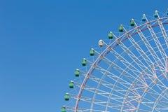 Big giants funfair ferris wheel against blue sky Stock Photo