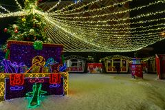 Big gift box decorated and lighted for Christmas and for New Year Eve royalty free stock images
