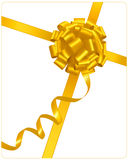 Big gift gold bow with a ribbon. Royalty Free Stock Photo