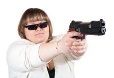 Big girl aiming a black gun stock photo