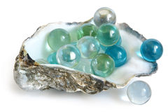 Big glass balls in shell of oyster Stock Photography