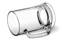 Big glass beer mug lying down Royalty Free Stock Photos
