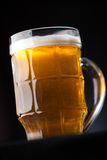 Big glass of beer over a dark background Royalty Free Stock Image