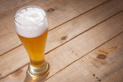 Big glass of beer on wood Royalty Free Stock Photography