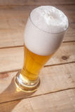 Big glass of beer on wood Royalty Free Stock Image