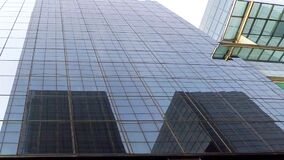 Big Glass Building Downtown Black Windows. This is footage of a glass office building downtown near all the highrises and department stores stock video footage