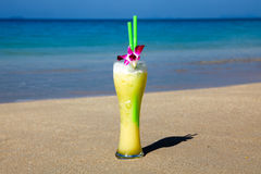 Big Glass Of Cocktail With Two Straws And Flower Royalty Free Stock Photo
