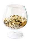 Big glass with coins royalty free stock images