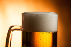 Big glass with handle filled with fresh beer with a lot of foam Royalty Free Stock Image