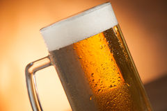 Big glass with handle filled with fresh beer with a lot of foam Royalty Free Stock Photo