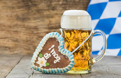 Big glass of lager beer in Bavaria at Oktoberfest in Munich. And sweet heart made with ginger bread and german inscription: i love you royalty free stock photos