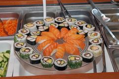 A big glass plate full of sushi stock photo