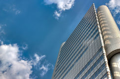 Big glass wall. Lonely skyscraper reaches the sky Royalty Free Stock Photography