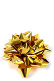 Big Gold Bow. Big gold christmas or birthday bow on a white background Stock Images