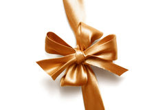 Big gold holiday bow on white background Stock Images