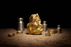 Big gold nugget and weights copper Royalty Free Stock Image
