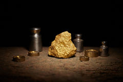Big gold nugget and weights copper Stock Photo