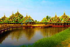 Big gold pavilion on water Royalty Free Stock Photography