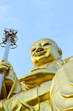 Big golden Bodhisattva statue with blue sky Stock Photos