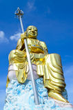 Big golden Bodhisattva statue with blue sky Stock Image