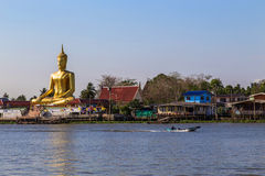 Big golden buddha be side the river. The view of big golden buddha be side the Chao Phraya river Stock Photography
