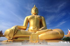Big golden buddha with blue sky. Royalty Free Stock Image
