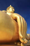 Big golden buddha with blue sky. Stock Photography