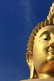 Big golden buddha with blue sky. Stock Photo