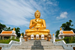 Big Golden Buddha with bluesky  south thailand. Big sitting Golden Buddha south of Thailand Royalty Free Stock Photo