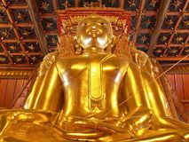 Big golden Buddha image in ancient Buddhist temple - Wat Phumin, Nan province, Thailand. Stock Images