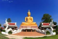 Big golden Buddha image. On blue sky Royalty Free Stock Image