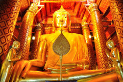Big golden buddha statue/Big golden buddha statue in the temple Stock Photos