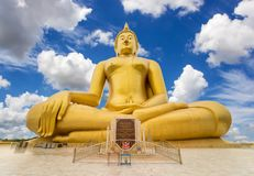 Big golden buddha statue. With blue sky background Royalty Free Stock Image