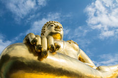 Big golden buddha statue with blue sky at Golden Triangle, Thailand Stock Images