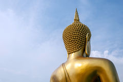 The big golden Buddha statue with clear blue sky Royalty Free Stock Photo