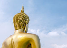 The big golden Buddha statue on clouds and sky. Royalty Free Stock Photos