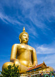 Big Golden Buddha statue. Shining in the sun Stock Photography