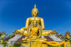 Big golden buddha statue sitting on thai temple Royalty Free Stock Photo
