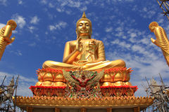 Big golden Buddha statue. Under construction Stock Photo