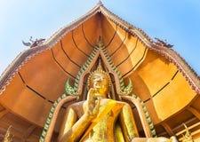 Big golden buddha statue in Wat Tham Sua public buddhist temple at Kanchanaburi Thailand. Stock Photo