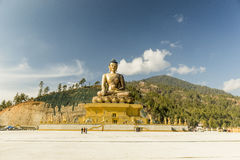 Big golden buddha in Thimpu Bhutan. One of the biggest golden buddha statues is in the capital of Bhutan Stock Images